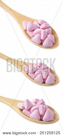 Healthcare Concept, Wooden Spoons Full With Vitamins Pills Isolated On White Background.