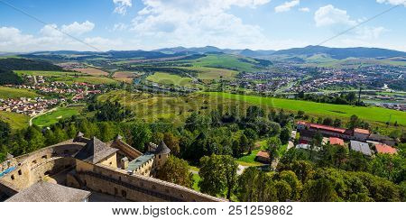 Mountainous Landscape Around The Castle. Old Town And River In The Valley. Mountain Ridge In The Dis