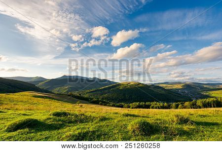 Beautiful Landscape In Afternoon. Gorgeous Blue Sky With Golden Clouds Over The Mighty Mountain Ridg
