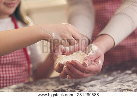 Detail Of Mother And Daugther Baking Cookies, Playing With Flour On The Kitchen Counter. Selective F