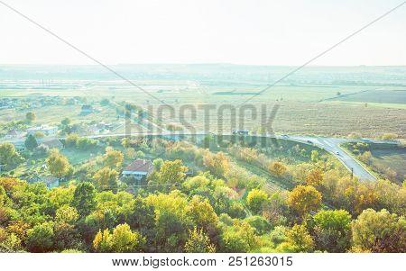 Car Driving On Road Bridge, Railway, Colorful Trees And Fields In Sunrays. Seasonal Scene. European