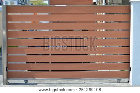 Wooden Brown Gate Of Garage For The Private House
