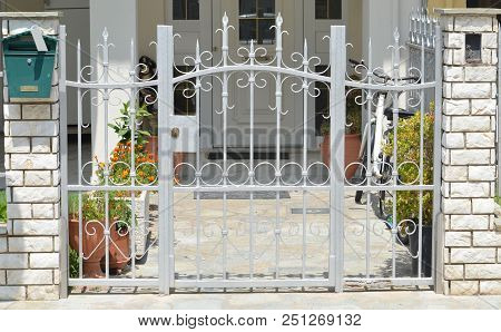 White Metal Gate For The Private House