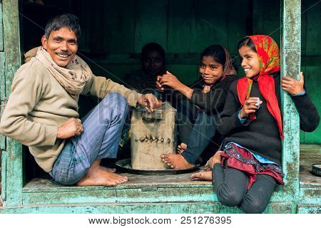 Ayodhya, India - Jan 27: Happy Girls And Father Smiling And Talking In Window Of Rural House On Janu
