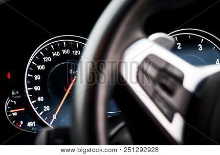 Modern Used Car That Has A Dirty, Dark Digital Tachometer