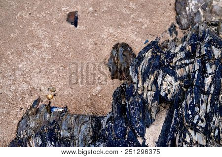 Detail Of Sand And Dark Rocks At The Beach In The South-east Of Ireland