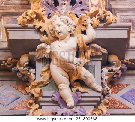Frescoes And Angel Sculpture In Church In Valencia