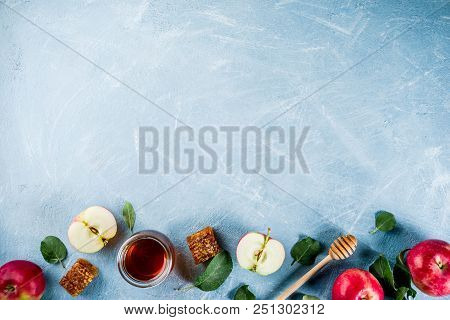 Jewish Holiday Rosh Hashanah Or Apple Feast Day Concept, With Red Apples, Apple Leaves And Honey In