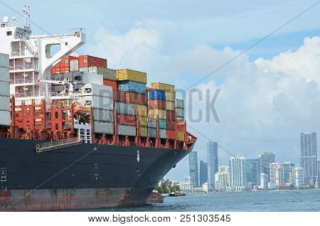 Containership Approaching The Port Of Miami,miami,florida With A Full Load Of Cargo.downtown Miami S