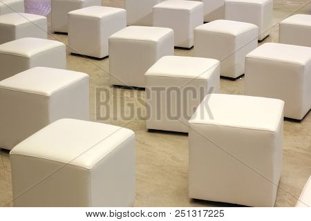 Pile Of White Leather Chair