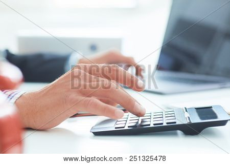 Close Up Of Businessman Or Accountant Handworking On Calculator To Calculate Business Data, Accounta