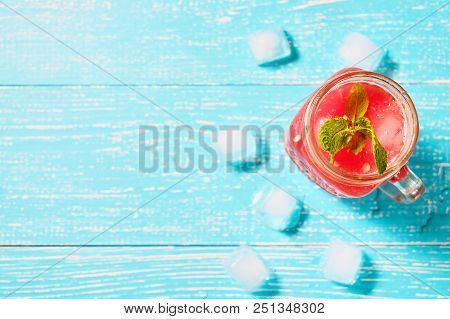 Watermelon Smoothie In Jar With Fresh Watermelon Slices On Blue Background With Copyspace Top View