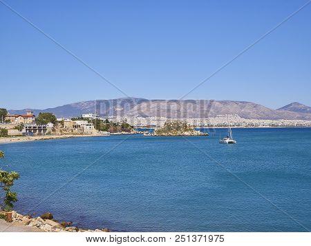 Mikrolimano Bay And Nisos Koumoudourou Island. Attica, Greece.