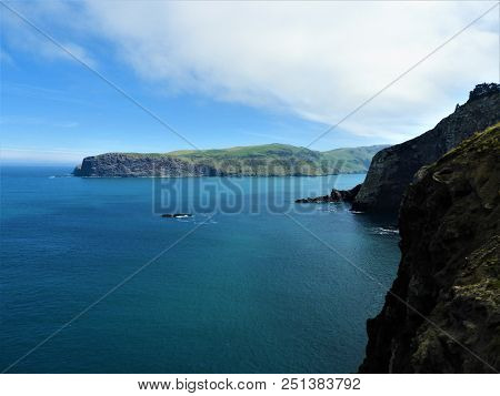 The Rough Cliffs Are Looking Over The Ocean