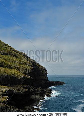 The Rough Cliffs Of Akaroa Peninsula On A Beautiful Day