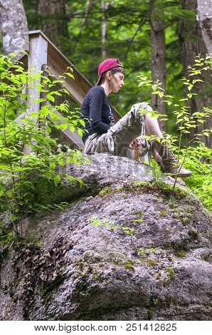 Franconia Notch State Park, New Hampshire, Usa - July 10, 2008: Hiker Meditating On Hillside In Fanc