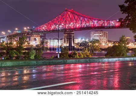 Montreal, Canada - 1 July 2017: Jacques Cartier Bridge Is Lit Up In Red To Celebrate Canada Day