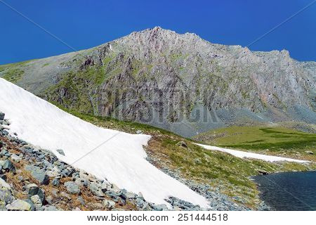 Beautiful Summer Landscape, Russia, Siberia, Altai Mountains. Snow In Mountains. Snowdrifts Of White
