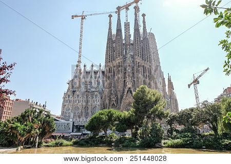Barcelona - July 19: View Of The Famous Sagrada Familia In Barcelona, Spain On July 19, 2018. Sagrad