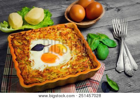 Baked Casserole Of Grated Potatoes With Eggs Sunny Side Up, Cheese. Ingredients For Casseroles - Che