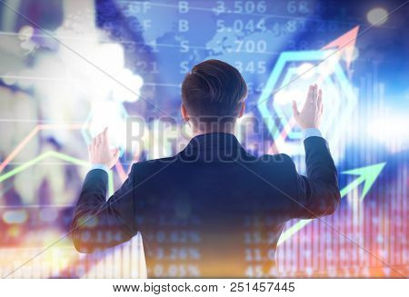 Stock broker working with graphs and rates on virtual screen. Financial trading concept
