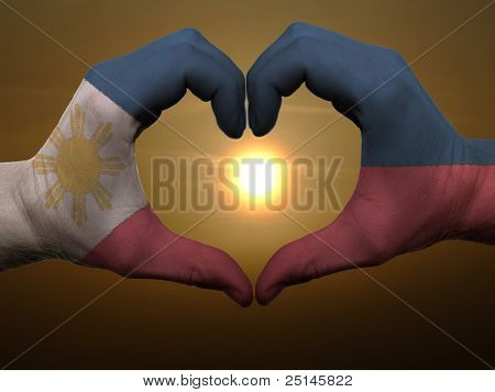 Heart And Love Gesture By Hands Colored In Phillipines Flag During Beautiful Sunrise