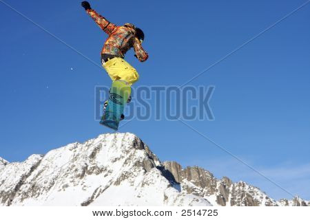 Snowboarder Jumping High In The Air