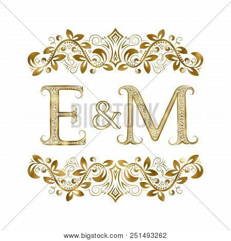 E And M Vintage Initials Logo Symbol. The Letters Are Surrounded By Ornamental Elements. Wedding Or