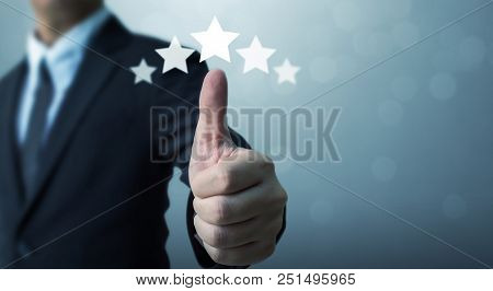 Businessman Showing Hand Sign Thumb Up And Five Star Symbol To Increase Rating Of Company, The Excel