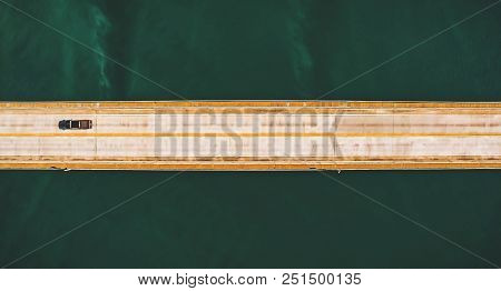 Aerial Top View Of A Long Highway Bridge Above A River.