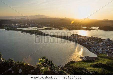 Orange Sunset View To Hallasan Peak From Ilchulbong Peak To The City Of Seongsan, Jeju Island, South
