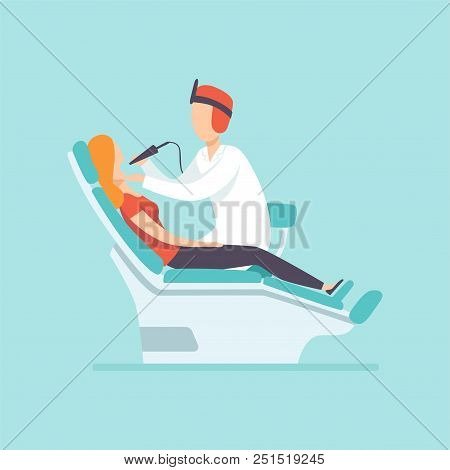 Male Dentist Examining Female Patient At Dental Clinic , Medical Treatment And Healthcare Concept Ve