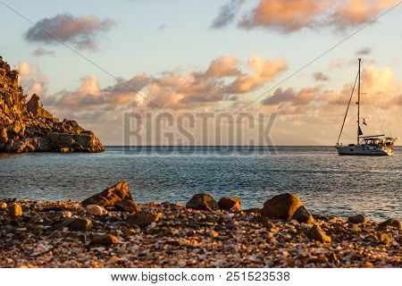 Travel Photo In St. Barths, Caribbean. Sailing Boat With A Beautiful And Pink Sky In Background In S