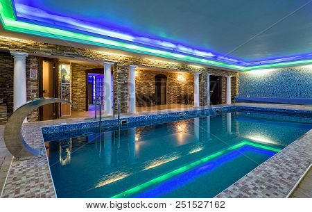 Moscow - May 2, 2018: Swimming Pool In Residential House Or Hotel. Modern Pool Interior With Green A