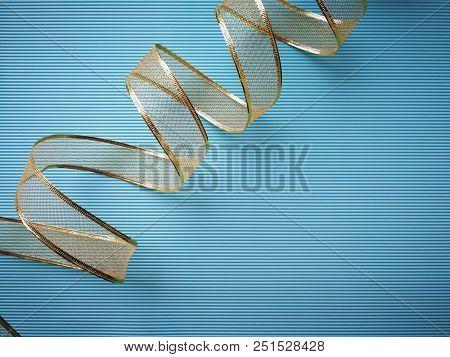 Golden ribbon on blue background