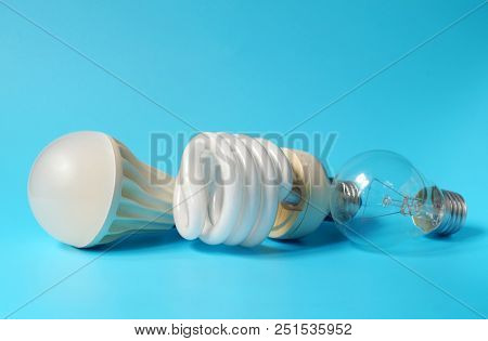 Led Lamp, Fluorescent Lamp And Incandescent Lamp On Blue Background. Save On Energy And Your Money W