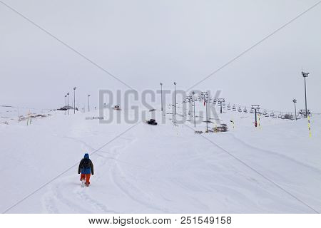 Ski slope with new-fallen snow after blizzard and gray sky in haze. Caucasus Mountains, Georgia, region Gudauri at snowy winter. poster