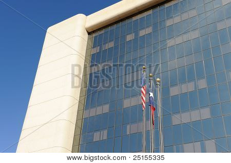 Government Building with Flag Poles