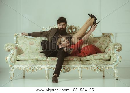 Love And Romance. Couple In Love Relax On Sofa. Love Relations Of Fashionable Couple. Stylish Couple
