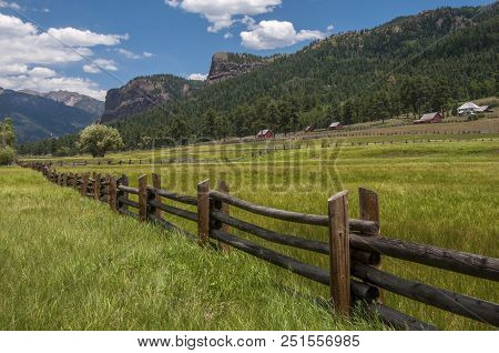 A Green And Lush Country Ranch Nestled Beneath Some Of The Rocky Peaks Of The Southern Colorado Rock
