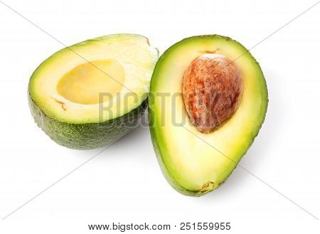 Halfs Of Ripe Avocado With Seed Isolated On White Background