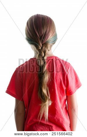 Little Girl With Colorful Dyed Red Highlights In Her Blond Hair Done In A Braid Or Plait Viewed From