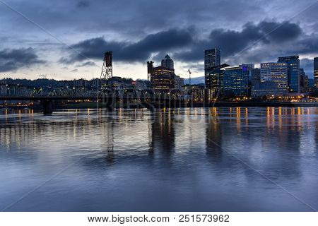 Portland Oregon Downtown City Skylinw By Hawthorne Bridge Along Willamette River At Evening Blue Hou