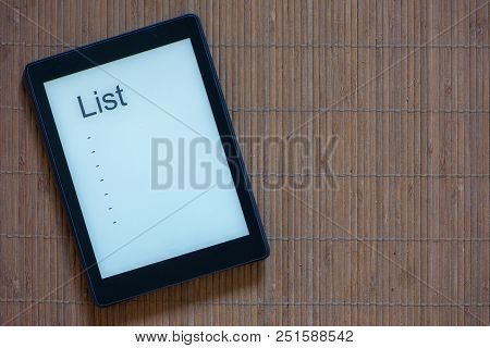 An E-reader With White Screen And Text List