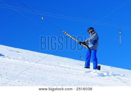 Snowboarder On Skilift