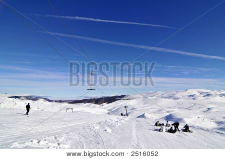 Snowboarders On Skilift