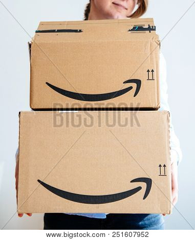 Paris, France - Mar 16, 2018: Happy Smiling Woman Holding Two Large Amazon Prime Cardboard Boxing Af