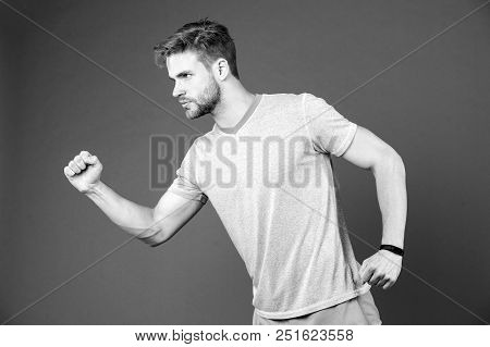 Man In Tshirt And Shorts On Violet Background. Runner In Blue Casual Clothes On Purple Background. S