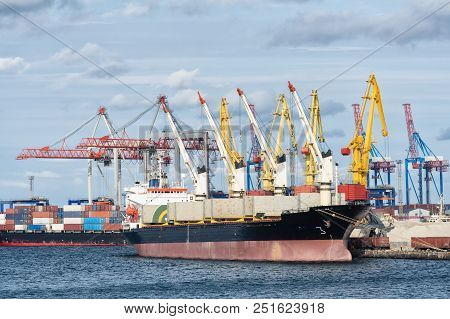 Container ship awaits loading containers / was unloaded at the port poster