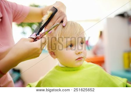 Preschooler Boy Getting Haircut. Children Hairdresser With Professional Tools - Comb And Scissors. C